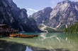 Boats Moored On Lake Against Mountains