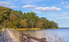 A Bridge Crossing The Water During The Start Of Autumn Along The Banks Of The Chesapeake Bay