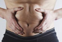 Man Touches His Fat Belly Clos...