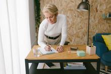 Focused Adult Businesswoman Ta...