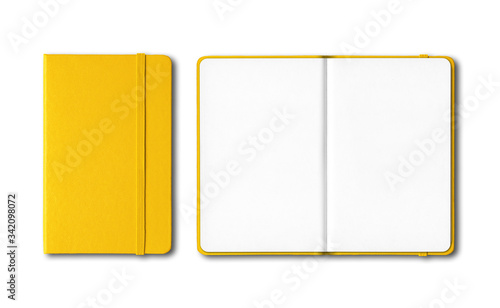 Obraz Yellow closed and open notebooks isolated on white - fototapety do salonu