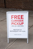 Free Curbside pickup sign outside store