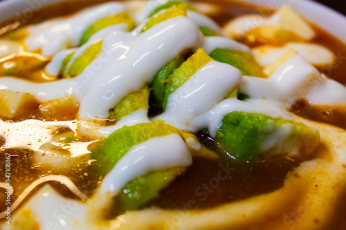 Mexican food dish, recipe for tortilla soup accompanied by a lot of avocado, c Wallpaper Mural