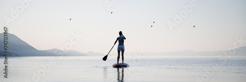 Woman paddling on sup board Canvas
