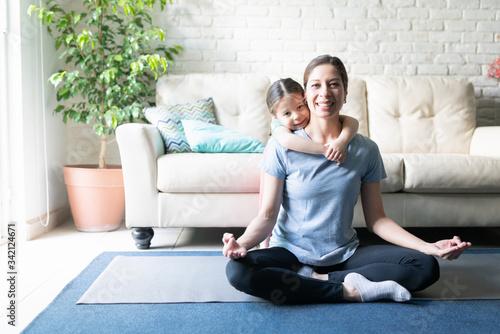Obraz na plátně Daughter and mother working out together