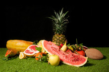 Various Fruits On Rug Against Black Background
