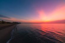 Sunset At The Beach. Sunrise O...