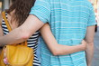 Midsection Of Young Couple Embracing On Street