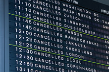 Airport Flight Information Board With Cancelled Flights