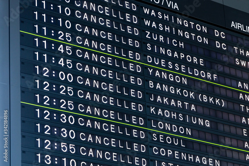Fotografiet Airport Flight Information Board With Cancelled Flights