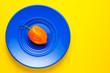 Leinwanddruck Bild - Habanero chili on blue plate and yellow background