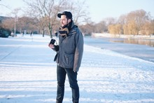 Full Length Of Man On Snow Covered Sidewalk In Winter