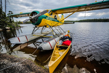 Canoe And Float Plane On A Lake