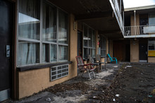 Old Abandoned Motel With Chair...