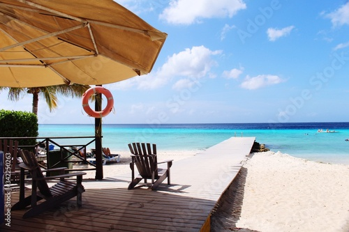 Adirondack Chair On Boardwalk At Beach Against Sky Fototapeta