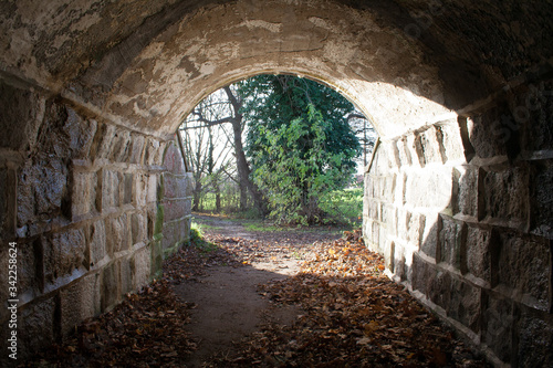 Photo Tunnel with light at the end, there is hope at the end, stone wall tunnel