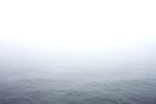Idyllic View Of Sea Against Sky During Foggy Weather