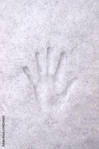 Handprint with fingers in white snow, background, texture. Tapéta, Fotótapéta