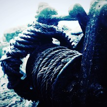 Close-up Of Rope On Metallic Pulley