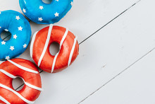 Donuts With Red Icing And Whit...