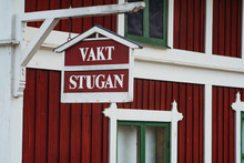 Red Wooden House With White Fr...