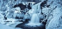 Frozen Waterfall In Forest