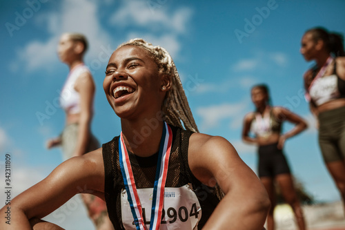 Fotografia Sportswoman with medal celebrating her victory