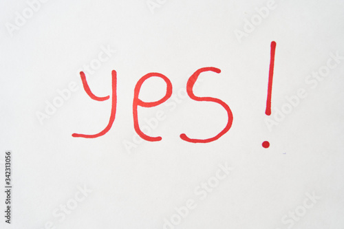 The inscription YES in red marker on a white sheet. Canvas Print