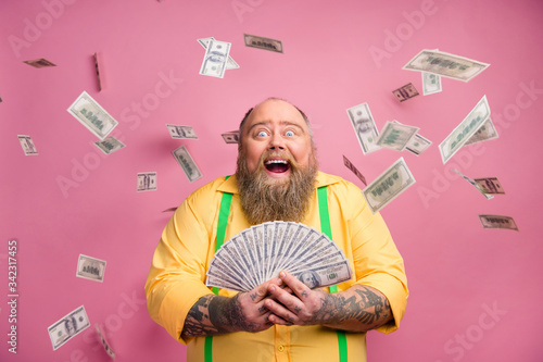 Obraz Close-up portrait of his he nice cheerful cheery wealthy bearded guy holding in hands bunch income subsidy donation usd for new life isolated over pink pastel color background - fototapety do salonu