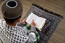 Back View Of Muslim Male Readi...