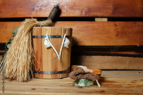 Photo steam room saunas and bath accessories such as bast, soap and washcloth awaiting
