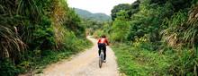 Woman Cyclist Riding A Bike On...