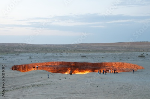 Fotografia People At Field By Door To Hell