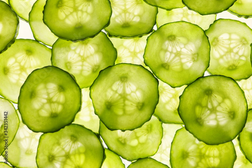 Cuadros en Lienzo Many cucumber slices as background