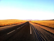 Highway In Desert Under Clear Sky