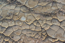 Cracked Red Clay And White Salt On The Surface In A Dried Riverbed In The Desert Of New Mexico, USA