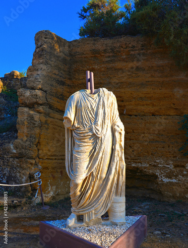 Agrigento / Italy  a white marble antic statue with tunic present in the ruins o Wallpaper Mural