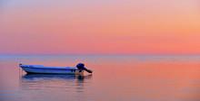 A Peaceful Sea With Warm Sunse...
