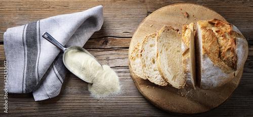 Fototapeta Durum wheat flour bread on old wooden background, top view. obraz