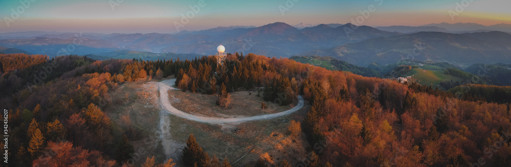 Fototapeta Aerial drone panorama view of a rain radar or meteorological doppler radar for measuring precipitation in early morning hours during sunrise on Pasja Ravan hill in Slovenia