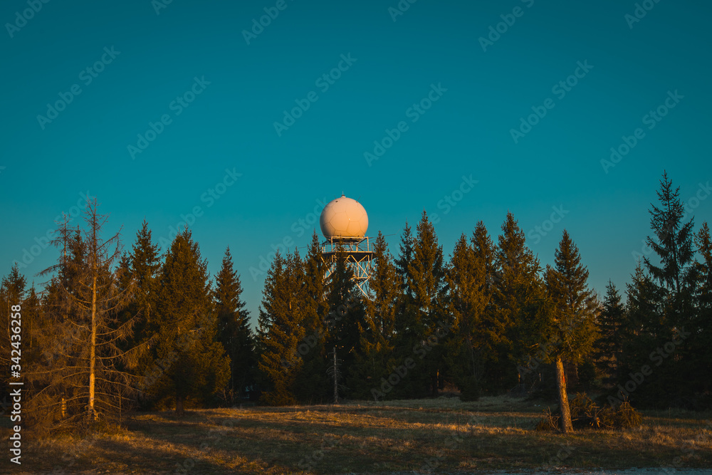 Fototapeta Wide view of a rain radar or meteorological doppler radar for measuring precipitation in early morning hours during sunrise on Pasja Ravan hill in Slovenia