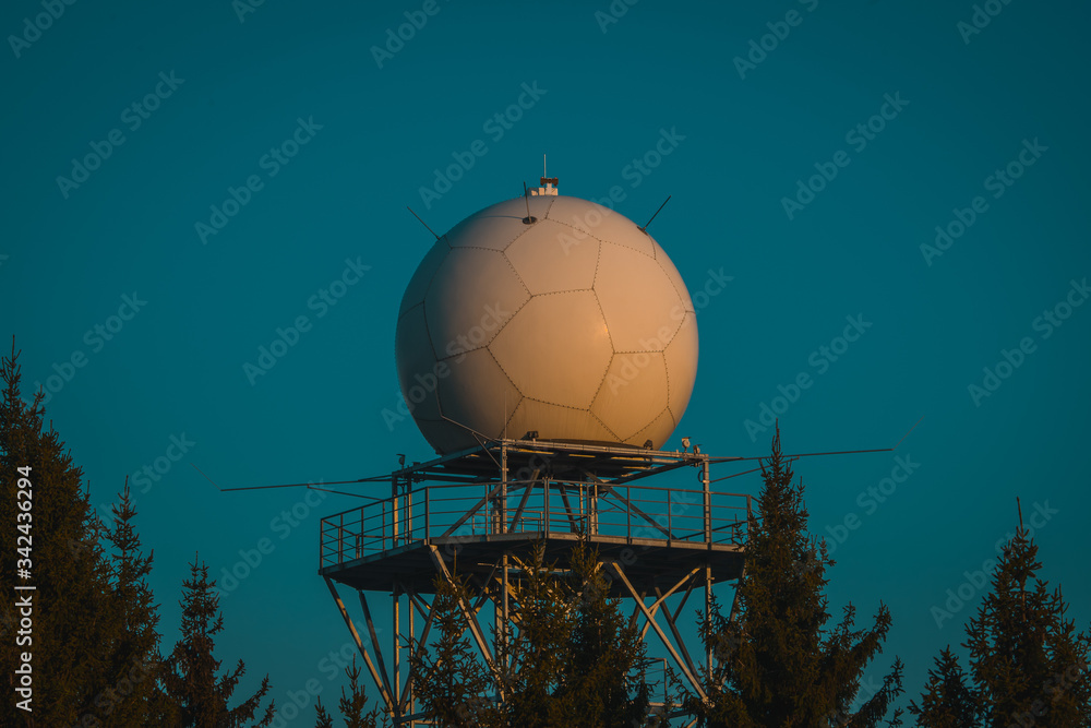 Fototapeta Detail view of a rain radar or meteorological doppler radar for measuring precipitation in early morning hours during sunrise on Pasja Ravan hill in Slovenia
