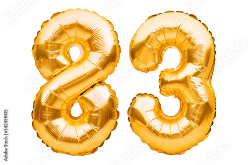 Tela Number 83 eighty three made of golden inflatable balloons isolated on white