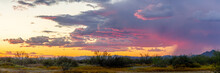 Panoramic Image Of The Sonoran Desert Of Arizona During Sunset With Distant Rain And Blue Skies.