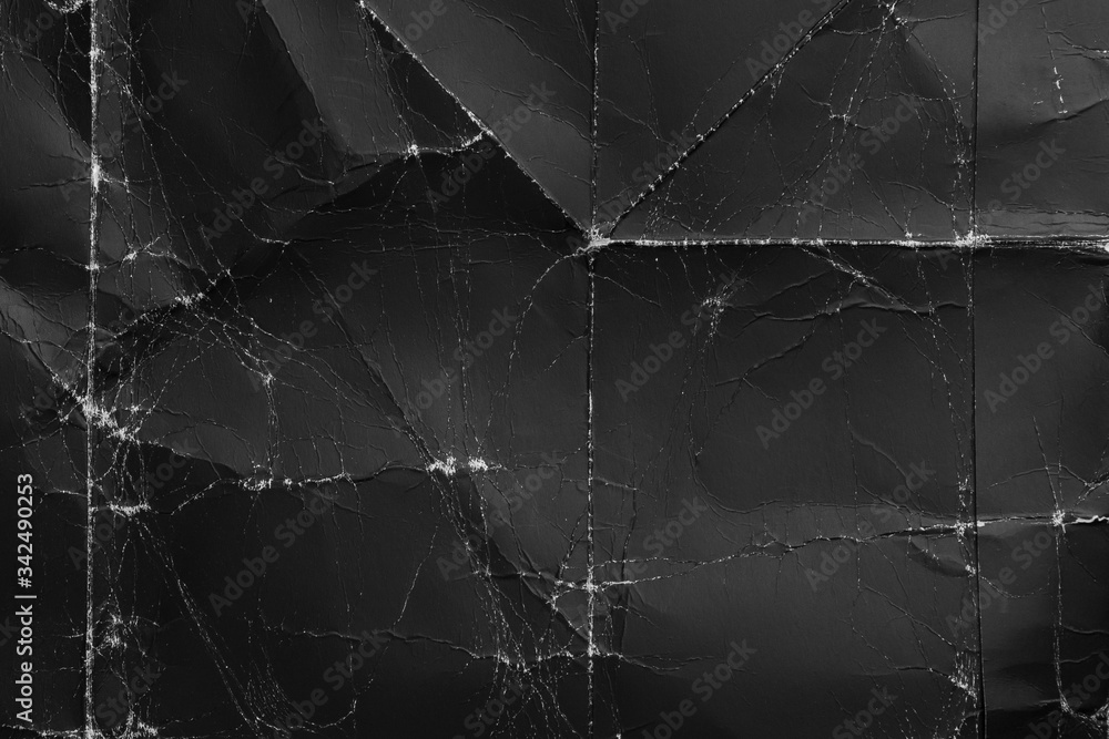 Fototapeta Wrinkled black old wrinkled paper. Dusty cardboard wrapping