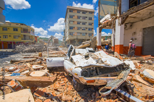 Photo Portoviejo, Ecuador - April, 18, 2016: Collapsed car, showing the aftereffect of 7