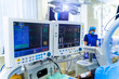 Two screens in operating room. Medical devices, Interior hospital design concept. Interior of operating room in modern clinic, monitor with tests closeup