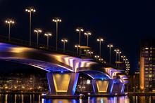 Illuminated Bridge Over Still ...