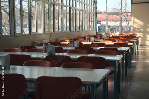 Fotografie, Tablou Empty seats of a highschool cafeteria after the cancellation of schools