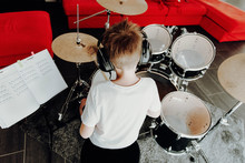 Young Boy Learning Playing Dru...